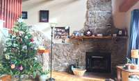 Living area, rock fireplace, is cosy