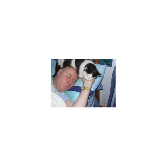 My husband Simon and Arthur our  late cat